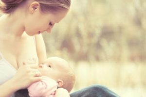 Breastfeeding.,Mother,Feeding,Her,Baby,In,Nature,Outdoors,In,The